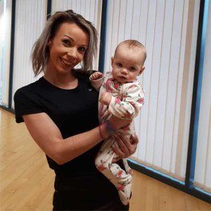 Amber holding Layla
