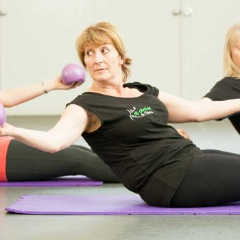 using-weight-balls in pilates